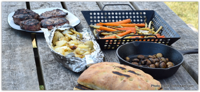 Backyard Camping Tips, Grilling food over open fire, Grilling dinner on fire pit, Steak on fir pit, Backyard Campout, Energize your summer, Camping in your backyard, Tips to make backyard camping fun, Energizer Flashlights,